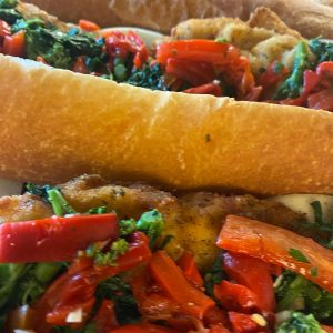 Chicken Cutlet with broccoli rabe, roasted peppers and provolone